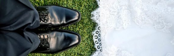 groom's shoes and hem of wedding dress
