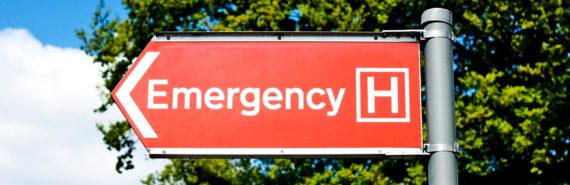 hospital emergency sign on road
