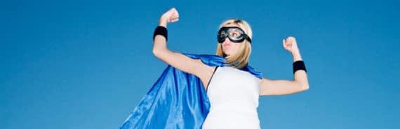 power poses - woman in superhero costume flexes