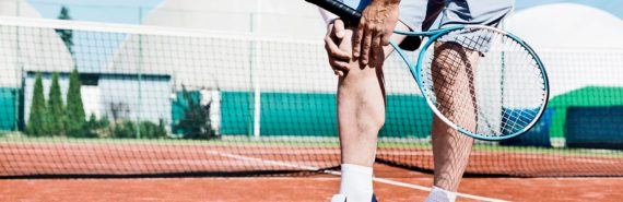 tennis player clutching knee