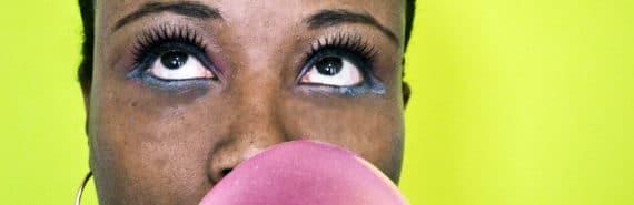 woman blowing bubble