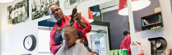 barber cuts child's hair