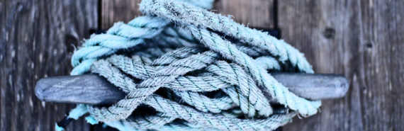 knotted blue rope on mooring