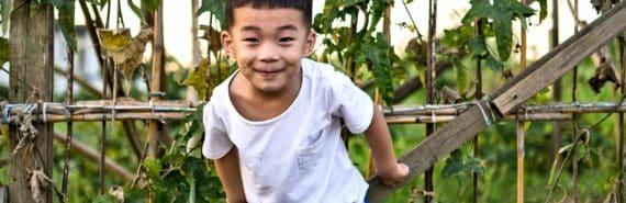 boy plays in garden