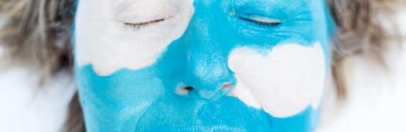 woman with blue cloud face paint