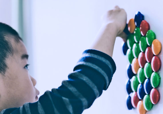 kid playing with fridge magnets