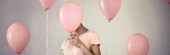 millennial pink balloons and hiding woman