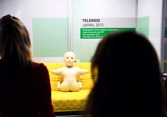 visitors look at robot exhibition