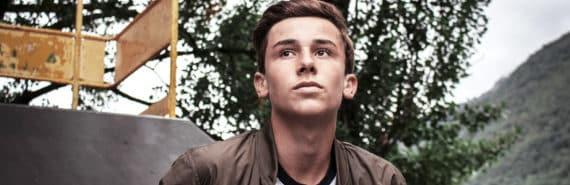 teen guy looking up