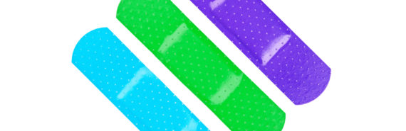 green, blue, purple bandaids on white