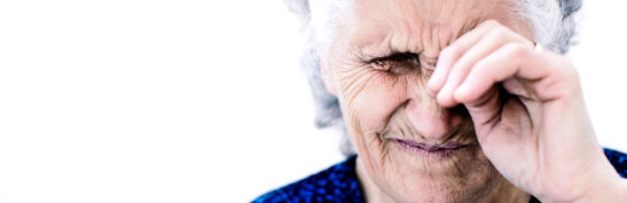 tired woman rubbing eye