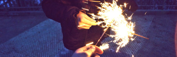 two sparklers touch