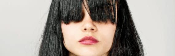 bangs cover woman's eyes
