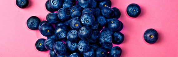 blueberries, pink background
