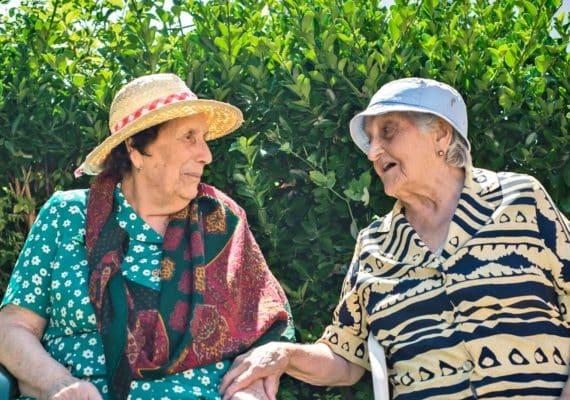 two elderly women friends chatting