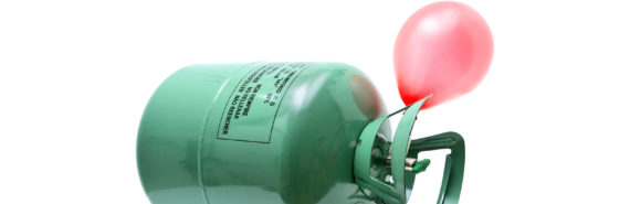 pink balloon and green helium canisters