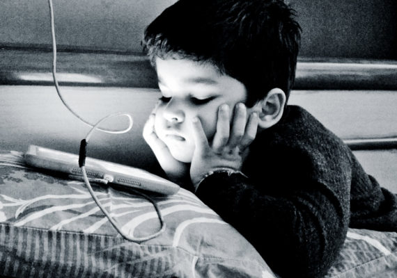 kid watching iPad