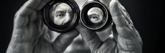 man looking through lenses