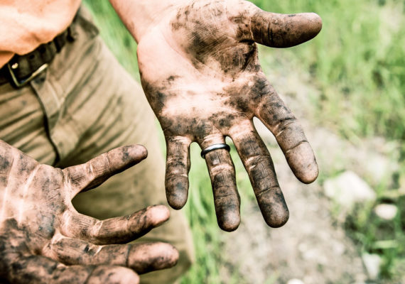 hands covered with soil