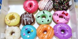 box of donuts with colorful frosting