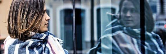 woman seeing reflection (bipolar disorder concept)