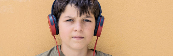 young teen boy with headphones (fathers, rejection, and social anxiety concept)