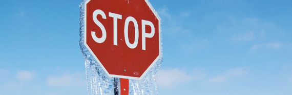 frozen stop sign (geoengineering and climate change concept)