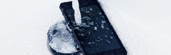 phone under faucet