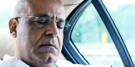 sleeping man in car