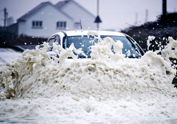 car drives into flood water