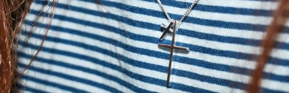 cross necklace on striped shirt