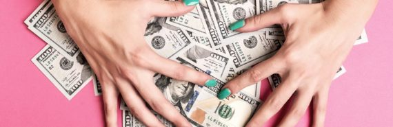 hands with green nails gather $100 bills