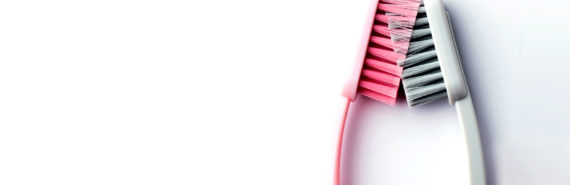 pink and gray toothbrushes mashed together