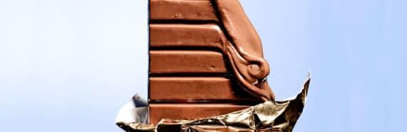 melting chocolate bar on blue