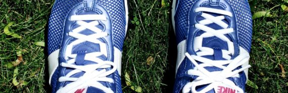 running shoes on grass (athlete's foot fungus concept)