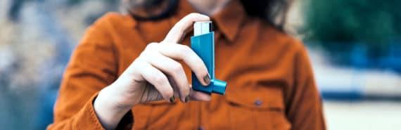 woman holding inhaler