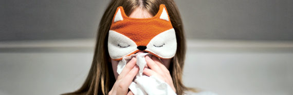 woman in fox sleeping mask with flu