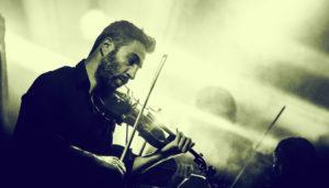 man plays violin