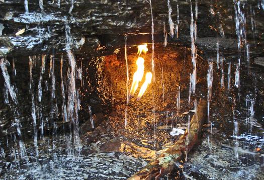 Rock gas fuels 'eternal flame' behind waterfall