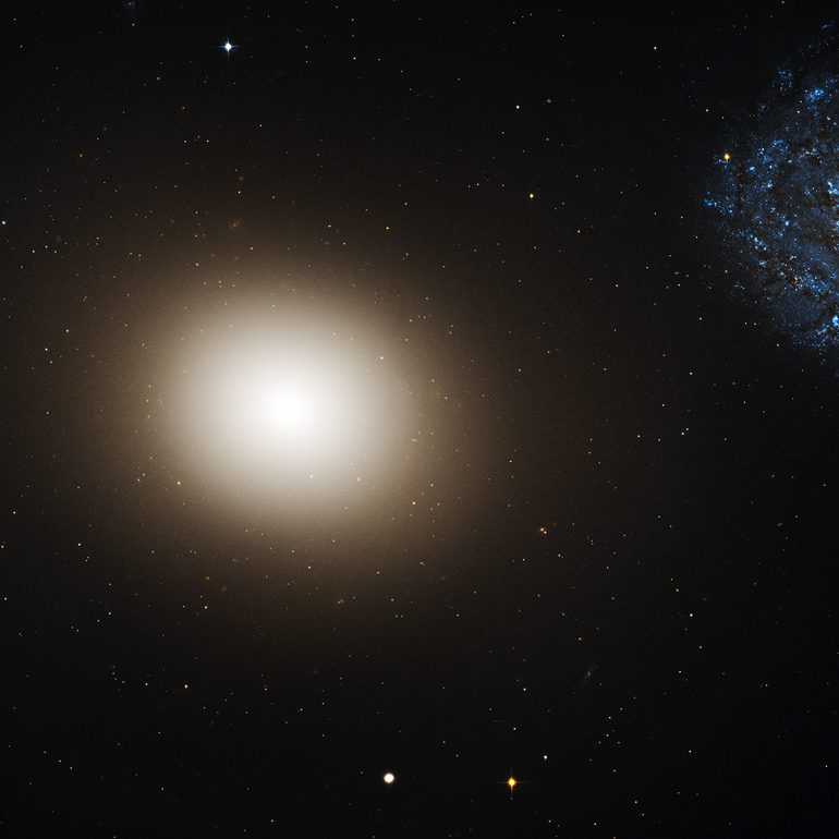 Hubble's view of Galaxy M60 and M60-UCD1. (Credit: NASA, ESA, CXC, and J. Strader/Michigan State)
