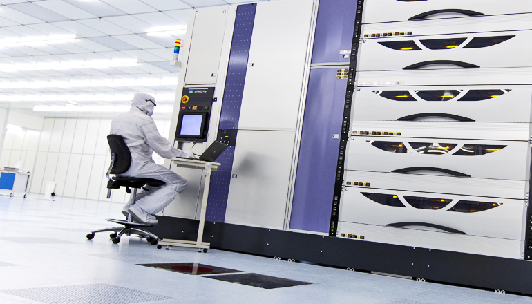 The track system coats, bakes, and develops thin polymer films on silicon wafers. (Credit: © IMEC)