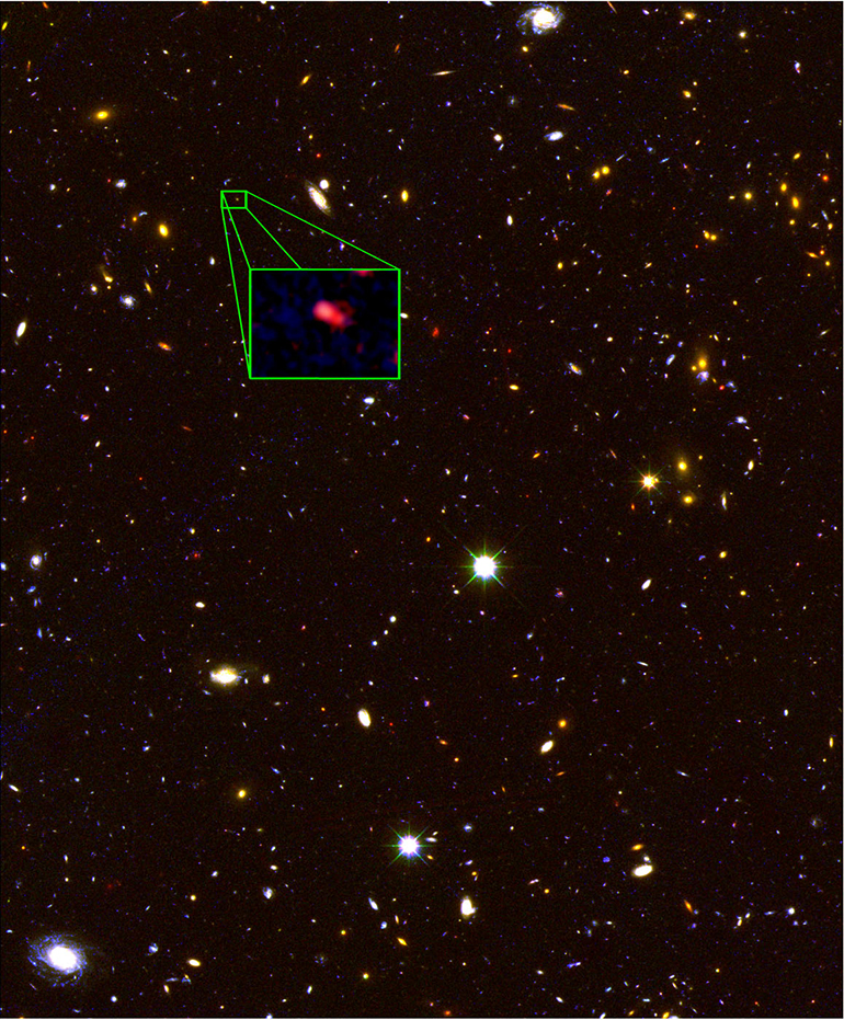 This image from the Hubble Space Telescope CANDELS survey highlights the most distant galaxy in the universe with a measured distance, dubbed z8_GND_5296. The galaxy's red color alerted astronomers that it was likely extremely far away and, thus, seen at an early time after the Big Bang. (Credit: