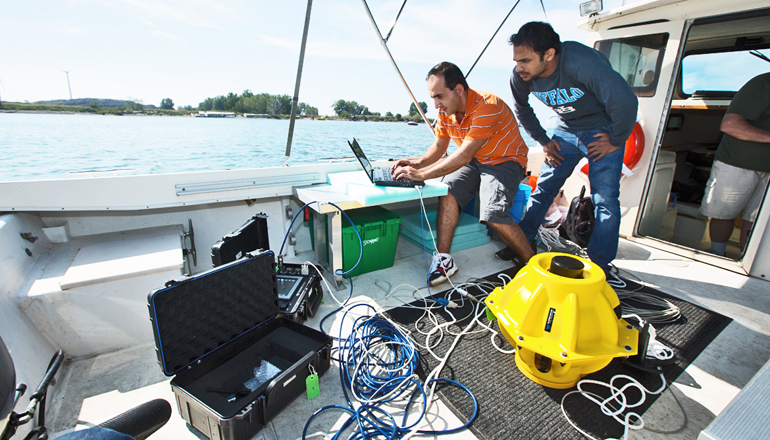 Researchers dropped two, 40-pound sensors into the water and then typed a command into a laptop. (Credit: Douglas Levere)