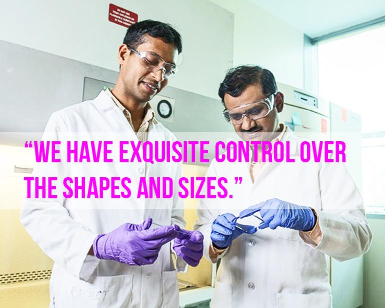 Krishnendu Roy (right) and Rachit Agarwal examine a silicon wafer. (Credit: Rob Felt)