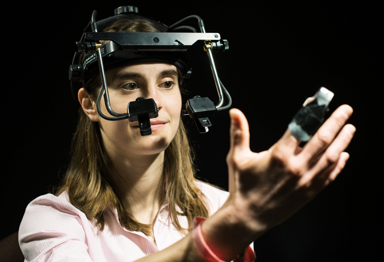 Lindsay Bronnenkant wears an eye-tracking device as she reenacts a study on synesthesia. (J. Adam Fenster/U. Rochester)