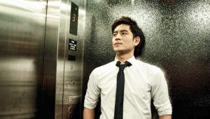 young professional man in an elevator