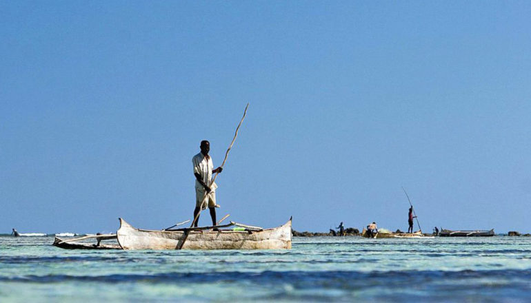 A man stands in his fishing boat