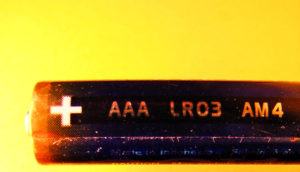 AAA battery on yellow background