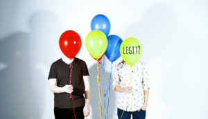 two people holding balloons