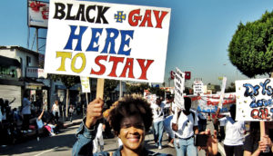 """protest sign """"black & gay here to stay"""""""
